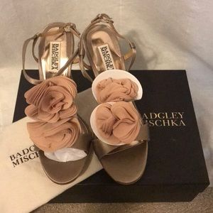 Badgley Mischka gold flower stilettos.
